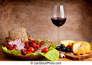 still life composition with traditional food and wine