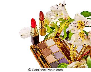 Still life decorative cosmetics and flower.
