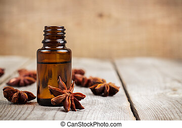Still life, food and drink, healthcare, beauty concept. Organic anise essential oil on a rustic wooden table. Selective focus, copy space background