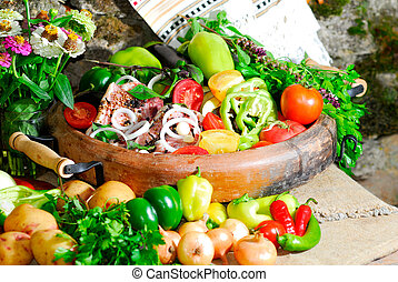 still life from vegetables and meat on the earthen dish in ...