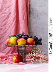 still life fruits in a vase and flowers