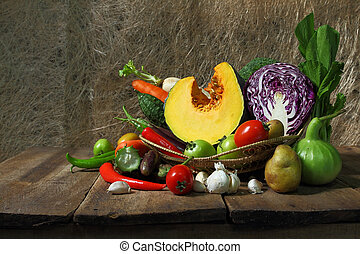 Still life harvested vegetables agricultural  on wooden background