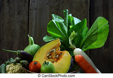Still life harvested vegetables agricultural  on wooden background