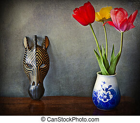 Still life - interior with flowers and african mask