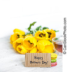 still life Mothers Day with yellow tulips and tea with ...