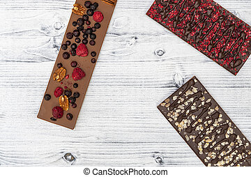 still life of chocolate with different kind dried fruit