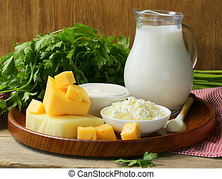 still life of dairy products (milk, sour cream, cheese, ...