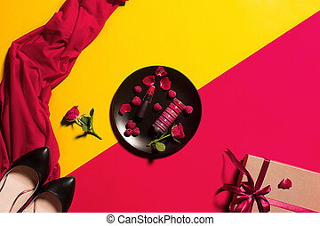 Still life of fashion woman, objects on yellow table