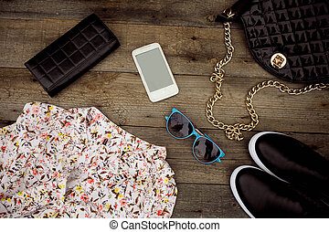Still life of fashion woman. Woman clothes and accessories on wooden background
