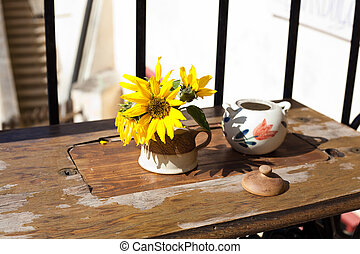 still life of flower and pot in a cafe
