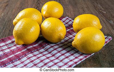 Still life of fresh lemons on a napkin