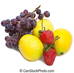 Still life of grape, lemons, strawberry on white background