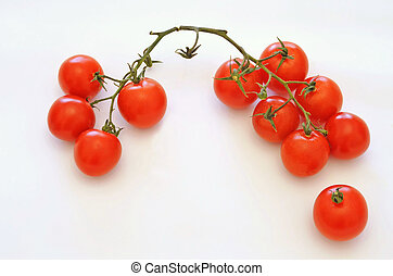 still life of little tomatoes on white background
