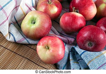 Still life of many apples on a napkin