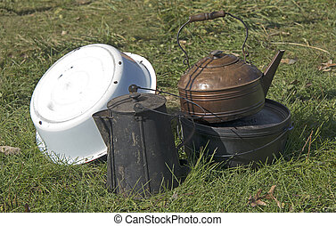 Still Life Of Old Pots And Pans Outdoors