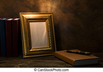 still life of picture frame on table with diary book