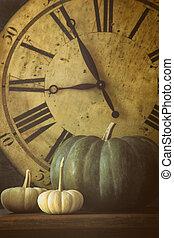 Still life of pumpkins and old clock