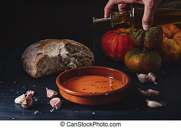 Still life of Salmorejo in a clay plate
