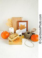 Still life on white. Pumpkins, autumn leaves