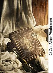 Still Life - Still life. Old book and rose.