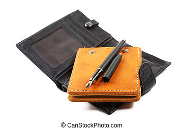 still-life purse and leather organizer with  pen isolated