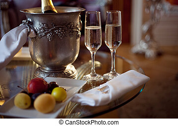 Still life, romantic dinner, two glasses and champagne in ...