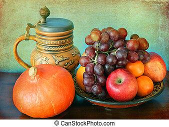 Still life: seasonal fruits and hokkaido pumpkin and a mug