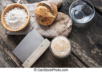 Still life setting of sourdough bread bun and ingredients