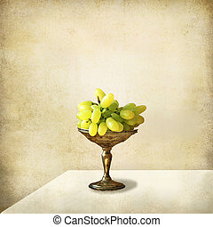 Still life, silver tray with grapes on a light grunge background