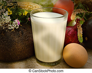 still life of different vegetables, milk, egg and flowers in...
