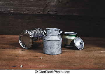 Still life Tin can on wood table background.