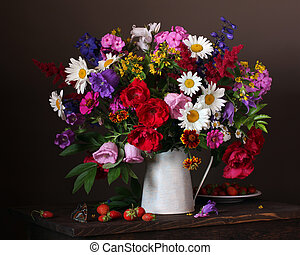 Still life with a bouquet of garden flowers in a jug.
