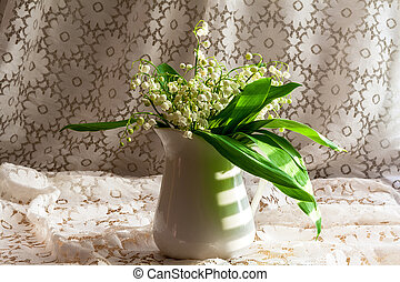 still life with a bouquet of lily of the valley