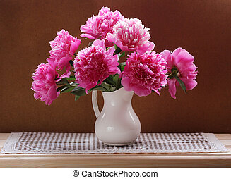 Still life with a bouquet of pink peonies. Flowers in a vase.