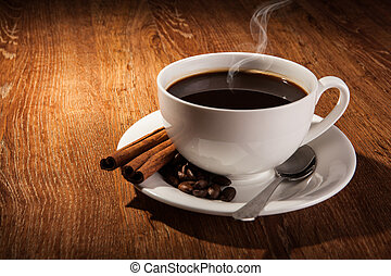 Still-life with a cup of black coffee and roasted coffee ...