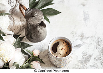 Still life with a cup of coffee and flowers