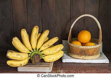 still life with banana and orange