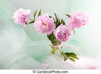 Still life with beautiful pink peonies in a glass vase
