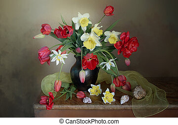 Still life with beautiful spring flowers in a vase on the table.