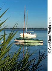 Still-life with boats at sunset light on the lake Balaton in Hungary