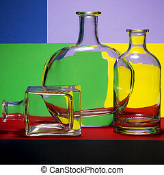 Still life with bottles on a colored background