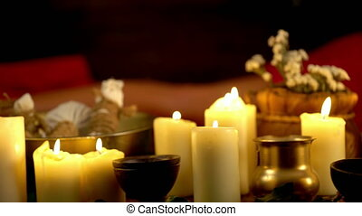 Still life with burning candles and massage herbs. 4k. -...
