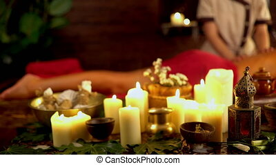 Still life with burning candles and massage herbs. 4k -...