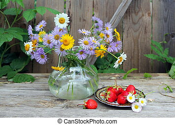 Still life with chamomile and strawberries