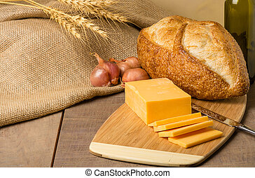 Still life with cheese and bread