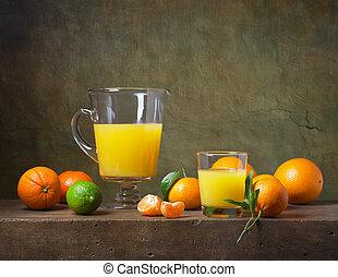 Still life with citrus fruit and orange juice