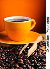 still life with coffee beans closeup and coffee cup
