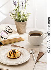 Still life with coffee, cake and a bouquet of lavender