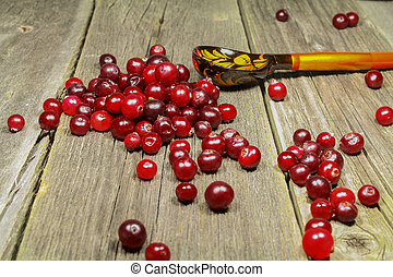 Still-life with cranberries on a wooden table