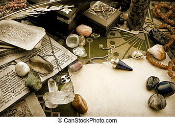 Still life with esoteric objects - Pendulum, gemstones and ...